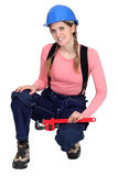 Female electrician holding spanner. Portrait of young female electrician holding spanner Stock Photography
