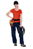 Female electrician raring to go. Young female electrician raring to go Royalty Free Stock Photo