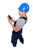 Female electrician. With a voltmeter Stock Images