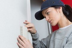 Female electrician at work. Electrician Royalty Free Stock Photo