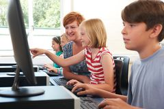 Female Elementary Pupil In Computer Class With Teacher stock images