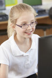 Female Elementary School Pupil In Computer Class Stock Photo