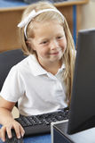 Female Elementary School Pupil In Computer Class Royalty Free Stock Images