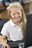 Female Elementary School Pupil In Computer Class Stock Photos
