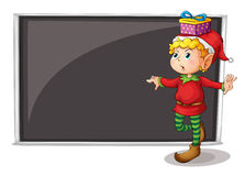 A female elf beside an empty gray board Royalty Free Stock Images