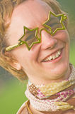 Female Elton John look-a-like. Royalty Free Stock Image