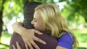 Female emotionally hugs interracial boyfriend, long lasting love relationship