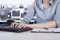 Female employee with computer in the office Stock Image