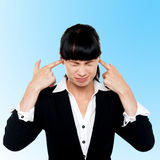 Female employee covering her ears Royalty Free Stock Photos