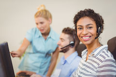 Female employee with coworkers working Stock Image