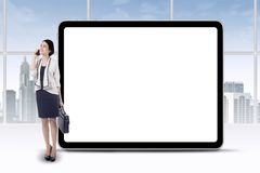 Female employee and empty board Royalty Free Stock Photo