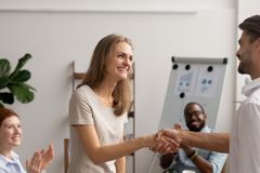 Young employee getting promotion handshaking with boss owner executive manager stock images