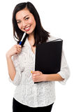 Female employee holding office files Royalty Free Stock Images