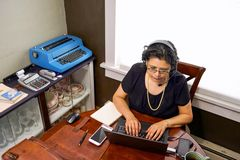 Female Employee In Home Office Setting Royalty Free Stock Photos