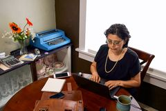 Female Employee In Home Office Setting Stock Photos
