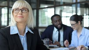 Female employee ignoring coworkers, dreaming own startup, financial independence