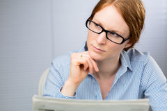Female Employee with a Newspaper Royalty Free Stock Photos