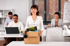 Female employee with personal stuff at office royalty free stock photos