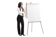 Female employee pointing on a presentation board Royalty Free Stock Photography