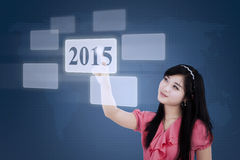Female employee pressing number 2015 Royalty Free Stock Image