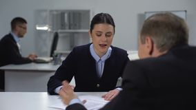 Female employee quarrelling with boss, proving data in document, work conflict. Stock footage stock video