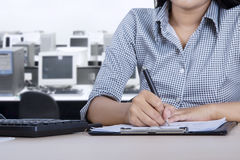 Female employee signing a document Royalty Free Stock Image