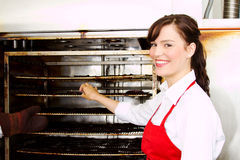 Female employee at smoked meats Stock Images