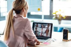 Free Female Employee Speaking On Video Call With Diverse Colleagues On Online Briefing With Laptop At Home Stock Photography - 183150112