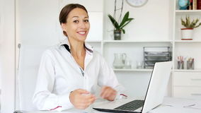 Female employee typing on portable computer stock footage
