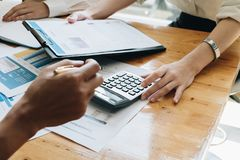 Female employee working with chart and calculator paperwork in o. Ffice room, Corporate Concept royalty free stock photography