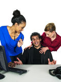 Female employees flirting with male boss Royalty Free Stock Image