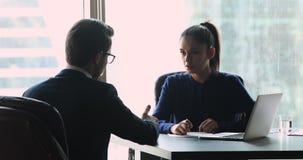 Female employer manager make financial deal handshake customer at meeting