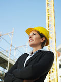 Female engineer. With arms folded looking away. Copy space stock photography