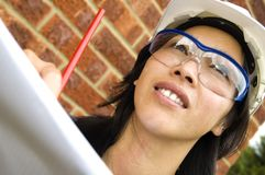 Female engineer. Studying plans on worksite Royalty Free Stock Photo
