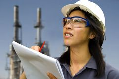 Female engineer. Taking notes on worksite Stock Photos