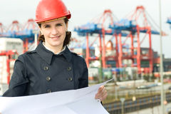 Female Engineer. Female civil engineer smiling at camera in front of container terminal in harbour Royalty Free Stock Images