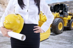 Female engineer with backhoe Stock Photo