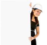 Female engineer with a banner Royalty Free Stock Images