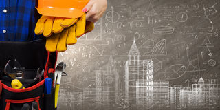 Female engineer. Bottom view of woman engineer with tool belt on waist Stock Images
