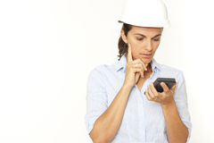 Female engineer calculating Royalty Free Stock Photos
