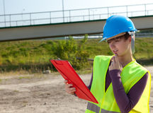 Female engineer in construction site Royalty Free Stock Image