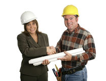 Female Engineer & Contractor Handshake. A female engineer and a building contractor shaking hands.  Isolated on white Royalty Free Stock Images