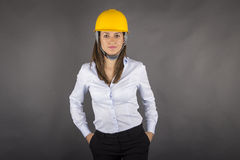 Female Engineer in fullbody wearing yellow helmet Royalty Free Stock Image