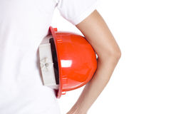 Female engineer hand holding red helmet. On white background Royalty Free Stock Image