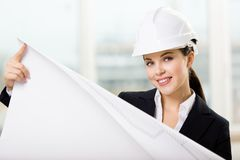 Female engineer in hard hat hands layout. Female engineer in white hard hat hands layout. Concept of successful construction Royalty Free Stock Image