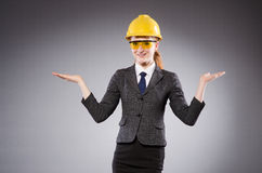 Female engineer with helmet isolated on gray Royalty Free Stock Photography