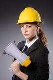 Female engineer with helmet Stock Images