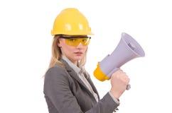 Female engineer in helmet with loudspeaker Royalty Free Stock Photos