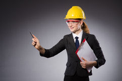 Female engineer with helmet and paper isolated on Stock Images