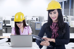 Female engineer and his partner working in office Stock Image
